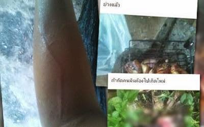 Thai boy eat his dog